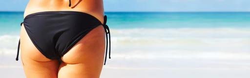 Woman butt on the beach Stock Photos