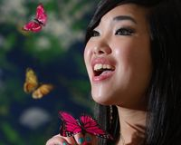 Woman with Butterfies Royalty Free Stock Image
