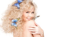 Woman with butterflies in hair Stock Photo