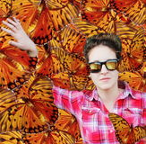 Woman among butterflies Stock Photos
