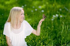 Woman and butterfly Stock Photography