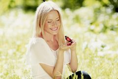 Woman and butterfly Stock Images