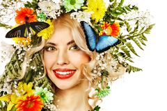 Woman with butterfly and flower. Stock Photo
