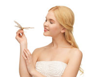 Woman with butterfly in hand Royalty Free Stock Photo