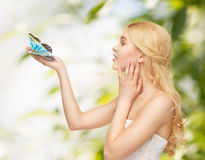 Woman with butterfly in hand Royalty Free Stock Images