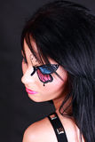 Woman with butterfly makeup. Woman with artistic butterfly makeup on black background stock photos