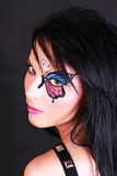 Woman with butterfly makeup Stock Image