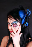 Woman with butterfly makeup. Portrait of beautiful woman with butterfly makeup on black background royalty free stock photo