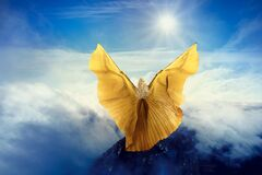 Free Woman Butterfly Wings Flying In Sky Clouds, Girl Standing On Mountain Peak, In Flight To Sun Royalty Free Stock Images - 206399889