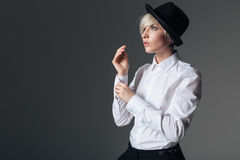Woman buttoning her shirt Stock Images
