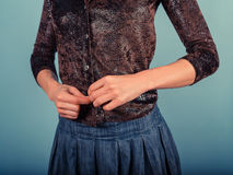 Woman buttoning her shirt Royalty Free Stock Photo