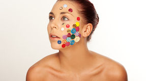 Woman with buttons on her face Royalty Free Stock Photography