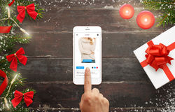 Woman buy clothes for Christmas gift online with smart phone Royalty Free Stock Photo