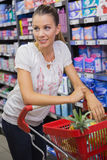 Woman buy products with his trolley Stock Photos