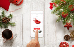 Woman buy shoes online with mobile phone during Christmas time Royalty Free Stock Photography