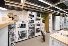 Woman buying appliances for kitchen royalty free stock photos