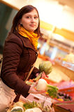 Woman buying artichokes and fennel bulbs at mark Royalty Free Stock Image