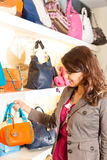 Woman buying a bag in mall Stock Photography
