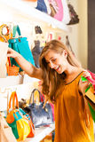 Woman buying a bag in mall Stock Photo