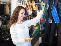 Woman buying bag in shop Stock Images