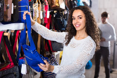 Woman buying bag in shop Royalty Free Stock Image