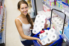 Woman buying bath tissue Royalty Free Stock Photography