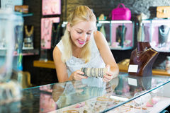 Woman buying bracelet in store Stock Images