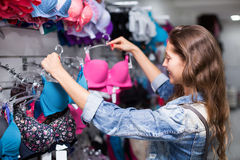 Woman buying brassiere Royalty Free Stock Photography