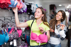 Woman buying brassiere Stock Images