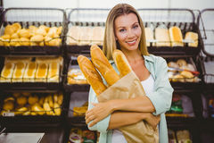 A woman buying bread in the pastries shelf Stock Photos