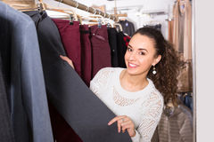 Woman buying breeches at the store Royalty Free Stock Photo