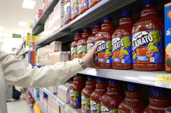 Woman buying Canada dry Mott's Clamato Stock Images