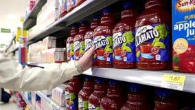 Woman buying Canada dry Mott's Clamato. Inside Walmart store stock video