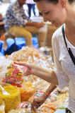 Woman buying candies Stock Photography
