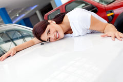 Woman buying a car Stock Image