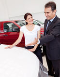 Woman buying a car Royalty Free Stock Photos