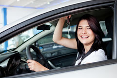 Woman buying a car Royalty Free Stock Photo