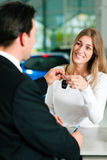 Woman buying car - key being given Royalty Free Stock Photos