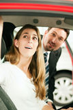 Woman buying car from salesperson Stock Image