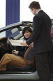 Woman buying car. Royalty Free Stock Image