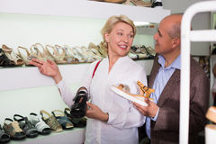 Woman buying casual shoes Stock Images
