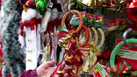 Woman buying Christmas decorations stock video footage