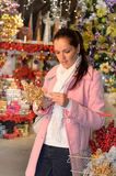 Woman buying Christmas ornaments in shop Stock Photos