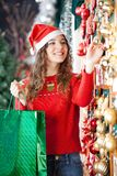 Woman Buying Christmas Ornaments In Store Royalty Free Stock Photography