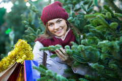 Woman buying Christmas tree Royalty Free Stock Photography