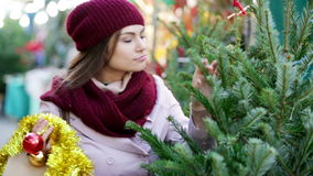 woman   buying Christmas tree stock video footage