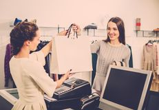 Woman buying clothes in a showroom Stock Images