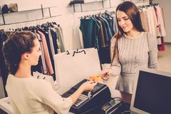 Woman buying clothes in a showroom Stock Photos