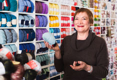 Woman is buying colorful yarn for their hobby Royalty Free Stock Image