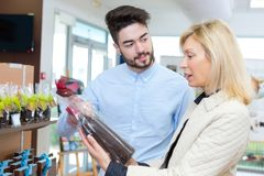Woman buying delicious chocolates royalty free stock photography